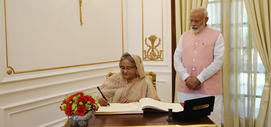 Sheikh Hasina, Prime Minister of Bangladesh signs the Visitor book in Hyderabad House during her State Visit to India
