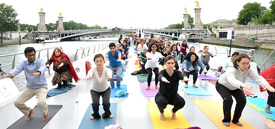 A high-visibility event , Yoga demonstration on-board the Bateaux-Mouche boat on the river Siene organized by Embassy of India, Paris