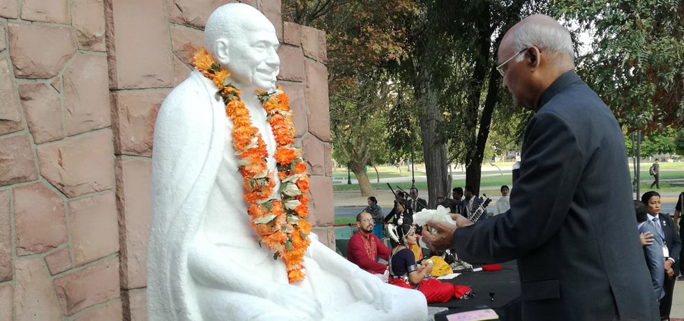 President offers flower petals at the Statue of Mahatma Gandhi in Santiago, Chile