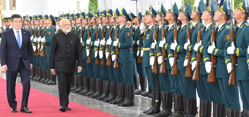 Prime Minister inspects Guard of Honour during his Ceremonial Welcome at the Ala Archa Presidential Palace in Bishkek