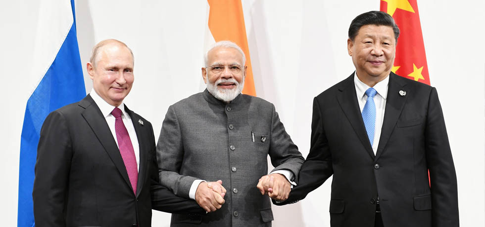 Russia-India-China trilateral meeting between Prime Minister, President of Russia Vladimir Putin and President of China Xi Jinping on the sidelines of G20 Summit 2019 in Osaka, Japan